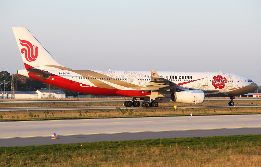 Vacating RWY07L after landing in the last light of the day. Inbound from Shanghai PVG. Delivered 11/2006.