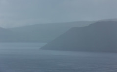 Ihe Islands of Sandoy and Hestur in the fog and rain, Faroe Islands