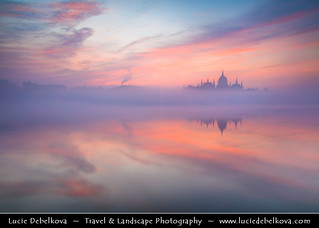 Hungary - Budapest - Hungarian Parliament Building - Iconic landmark reflected at Danube River during misty sunrise