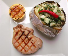 GRILLED PORK CHOP, CARAMELIZED LEMON, BAKED POTATO AND MAST-O KLAR
