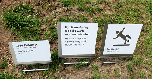 Signs at a Sculpture by Jean Dubuffet in the Kroller Muller Sculpture Garden near Utrecht, Holland