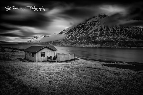 light sea sky bw white house lake snow seascape black mountains ice nature water grass clouds landscape iceland cabin cottage lawn east seydisfjordur fjords
