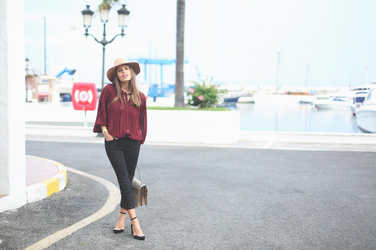 3. jessie chanes burgundy blouse cropped black jeans gucci bag