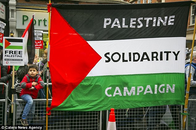 Free Palestine demonstrators outside the Israeli embassy in London