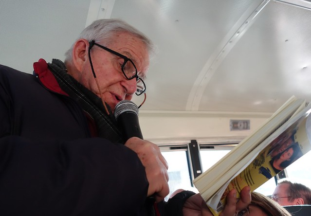 Dan Wakefield reading on bus