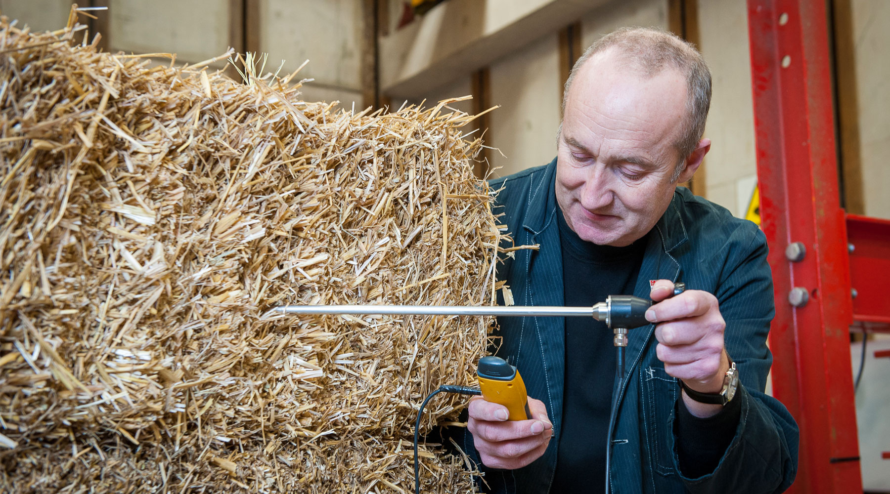 Professor Peter Walker and straw bale