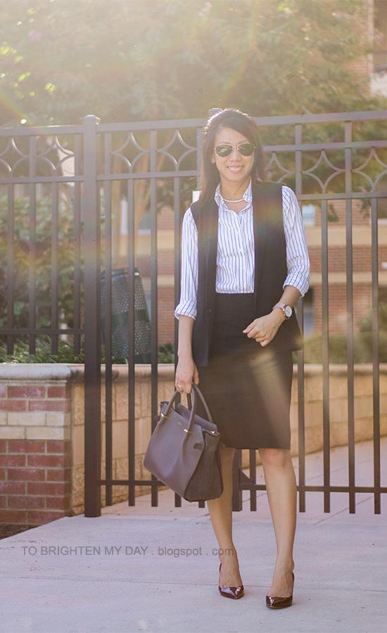 black vest, striped button up shirt, black pencil skirt, oversized watch, burgundy pumps