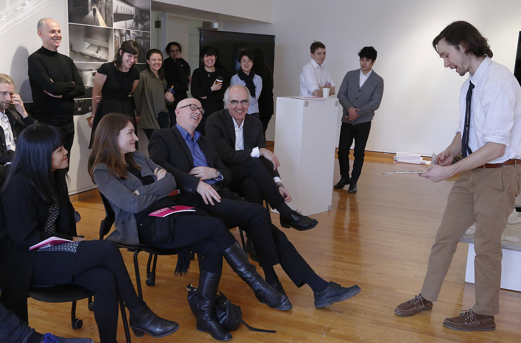 Visiting critics and faculty advisors react during the thesis review of Mark Leskovec in John Hartell Gallery.