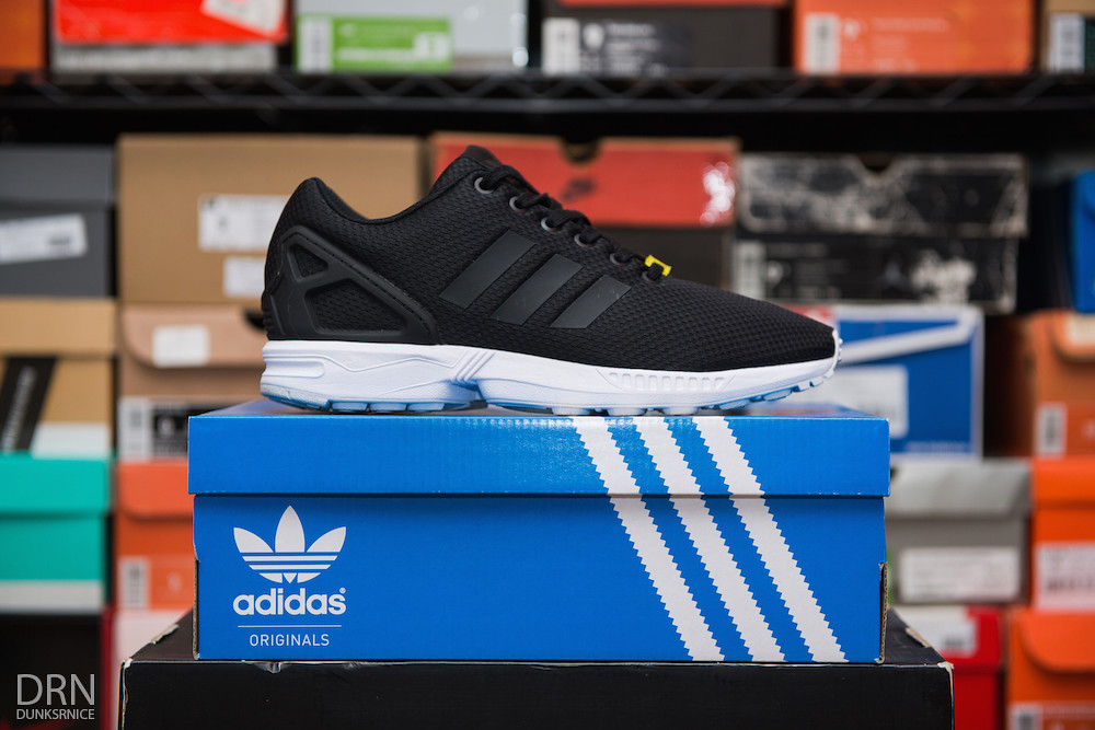 Black Adidas ZX Flux's.