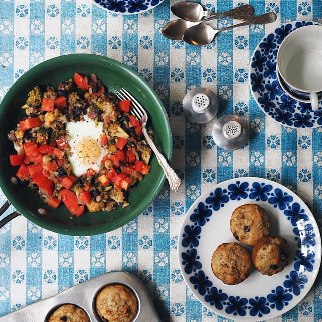 Lazy breakfast.  For those keeping score: Mum's vegetarian hotpot dinner leftovers (put all the veggies in a pan, add beans & spices, serve on brown rice) reheated with an egg and extra tomatoes from the garden, grandmother's muffins and swoon-worthy chin