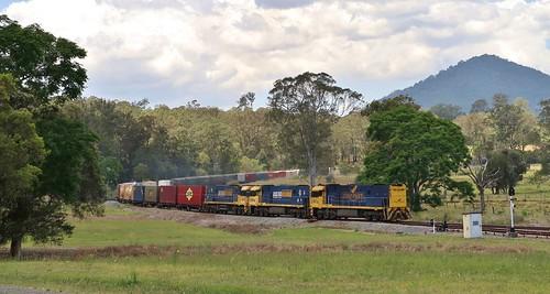 Running long end leading due to an earlier loco failure, NR27+NR69+NR44 bring train 6BA6 through Mount George, NSW.