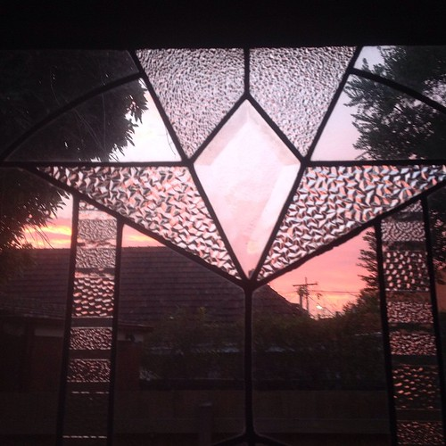 Sunrise through a cut glass window.