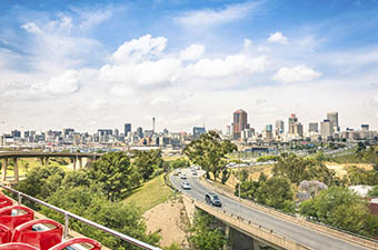 Wide angle view of Johannesburg skyline from the highways during a sightseeing tour around the urban area - Metropolitan buildings of the business district in the capital of South Africa