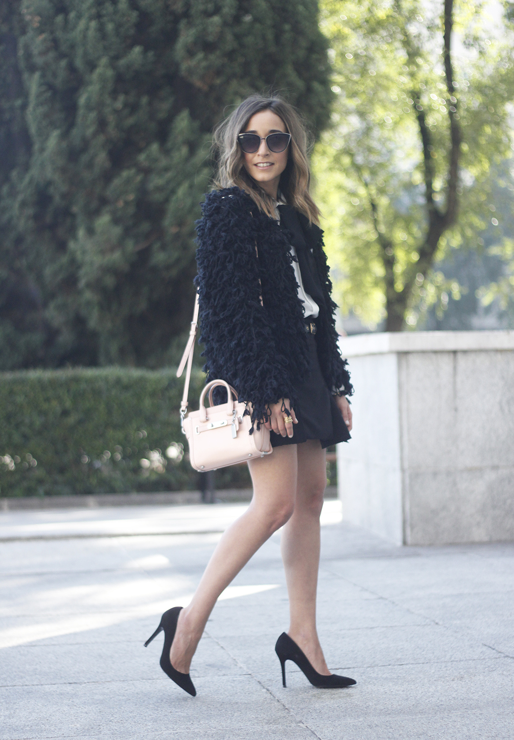 black jacket shirt with black bow coach pink bag heels outfit14