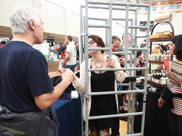 Woman in cage speaks with man