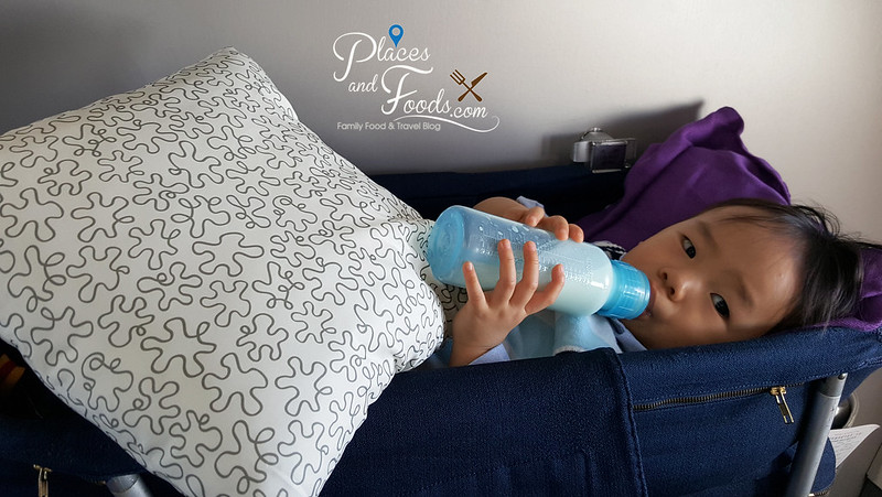 flying with baby zen in bassinet drinking milk