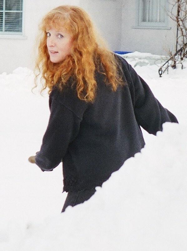 Judy Scott shovelling the snow on Kinross Ave
