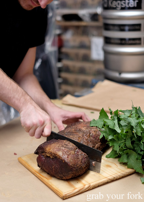 Carving the water buffalo sirloin at the Feral Party by Pinbone at Young Henrys for Good Food Month 2015