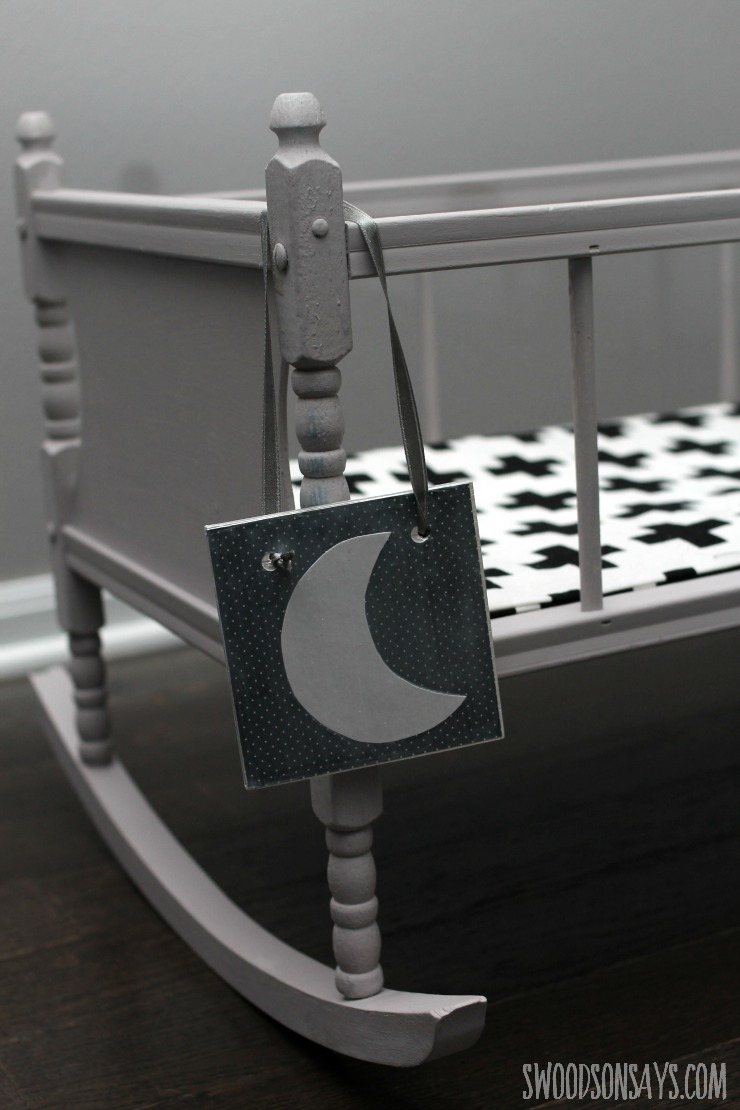 Modern baby doll crib with a day and night sign