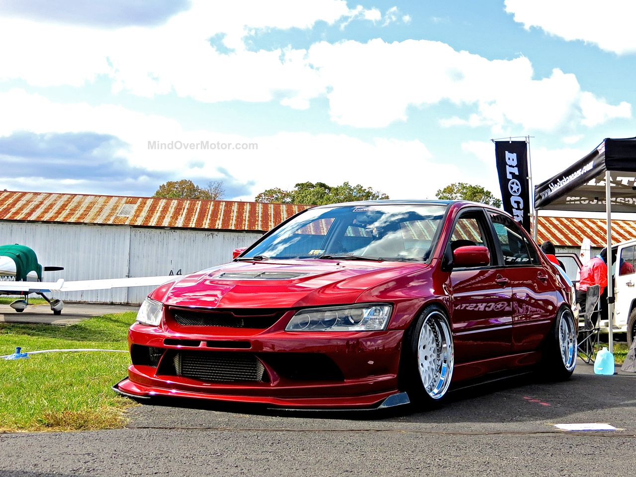 Stanced Red Mitsubishi Evo First Class Fitment 1