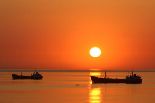 sea sun sunrise ships badge