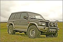 mitsubishi challenger(0.0), toyota land cruiser(0.0), automobile(1.0), automotive exterior(1.0), sport utility vehicle(1.0), wheel(1.0), vehicle(1.0), mitsubishi pajero(1.0), compact sport utility vehicle(1.0), off-roading(1.0), bumper(1.0), land vehicle(1.0), luxury vehicle(1.0),