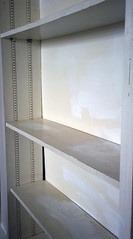 cupboard(0.0), bathroom cabinet(0.0), window covering(0.0), wardrobe(0.0), cabinetry(0.0), shelving(1.0), shelf(1.0), closet(1.0), furniture(1.0), interior design(1.0),