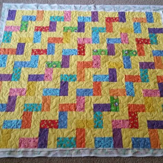 Scrappy rail fence quilted.