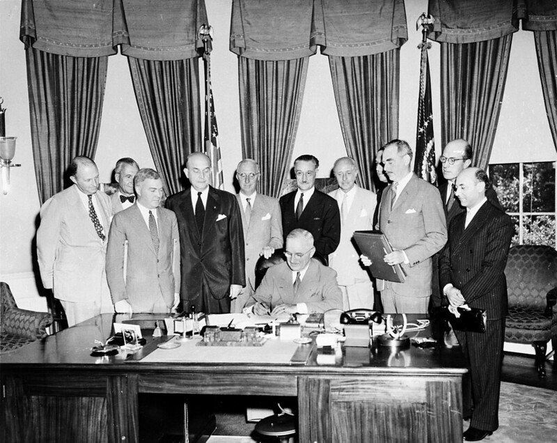 US president Harry S. Truman signing the North Atlantic Treaty