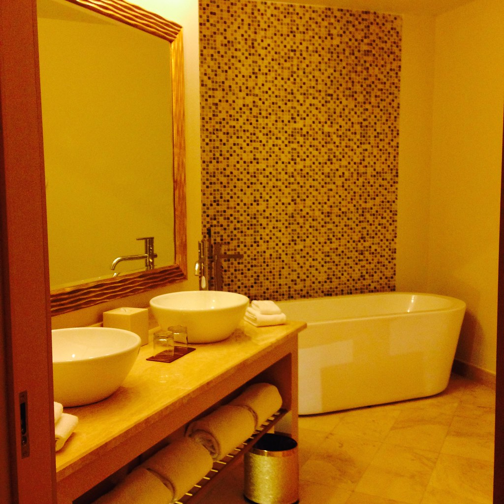 Double vanity and tub at Waldorf Astoria Junior King Suite