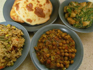 Indian Buffet Trio: Saag Aloo, Chana Masala, and Vegetable Biryani, with Garlic Naan
