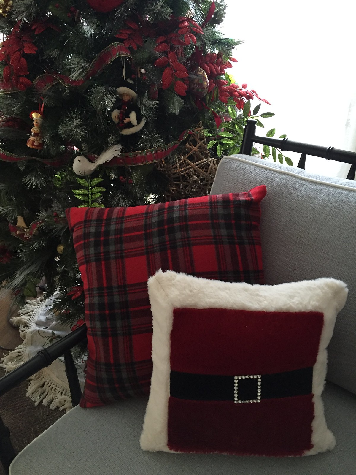 fun santa cushion on chair in front of christmas tree