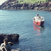 Small photo of Alf's boat backs out of Skomer, South Haven.