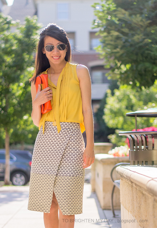mustard yellow top, brocade wrap skirt, orange clutch