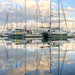 Clouds and Masts at Dawn by John E Adams