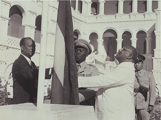Sudan's flag raised at the independence ceremony by the Prime Minister Isma'il Alazhari