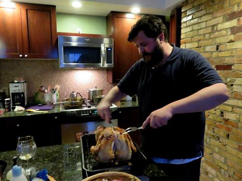 Caleb carving  the turkey