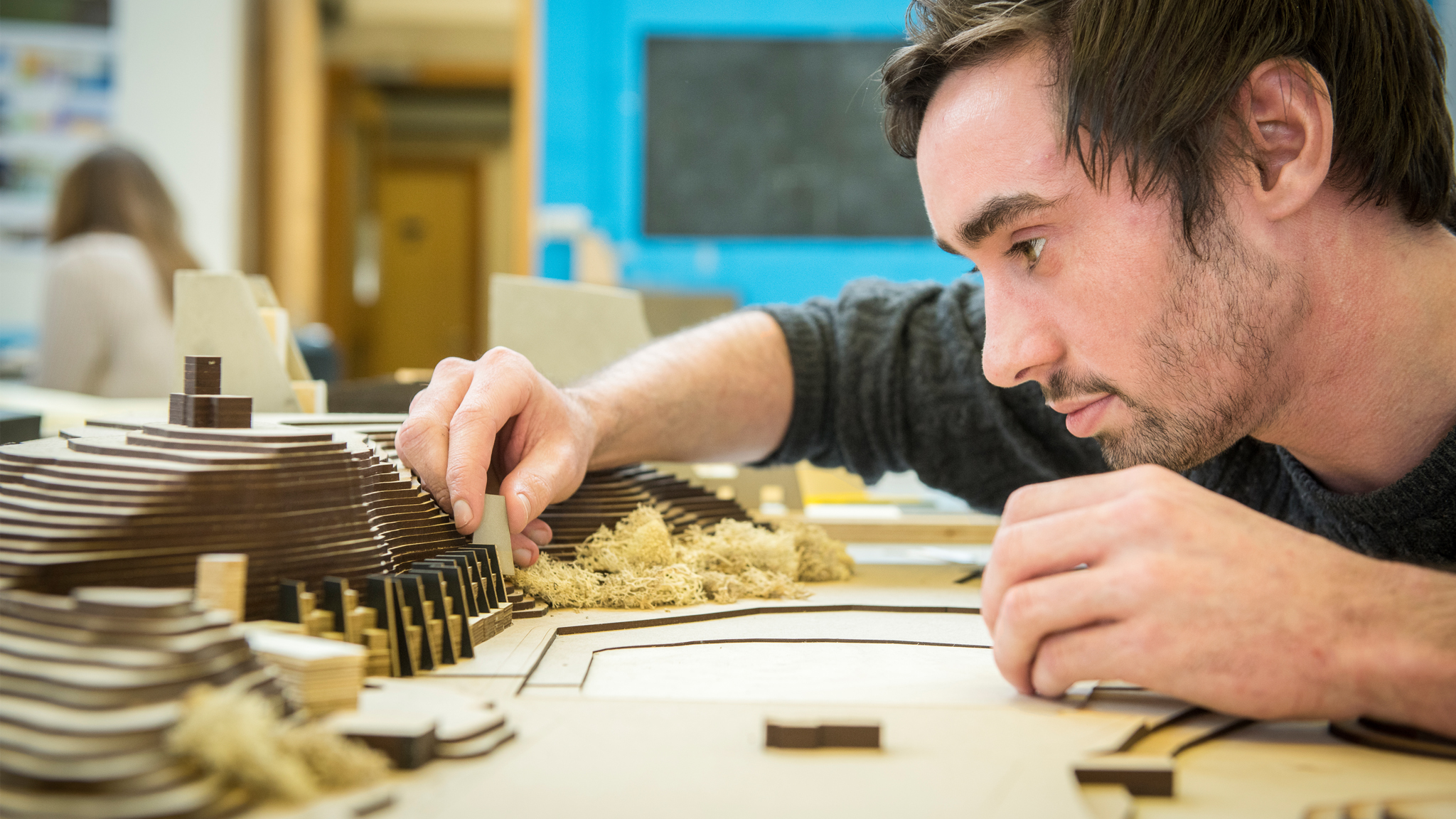 Close up of student working on an architectural model