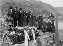 A family gathered around a coffin at the church yard, ca. 1912-1920