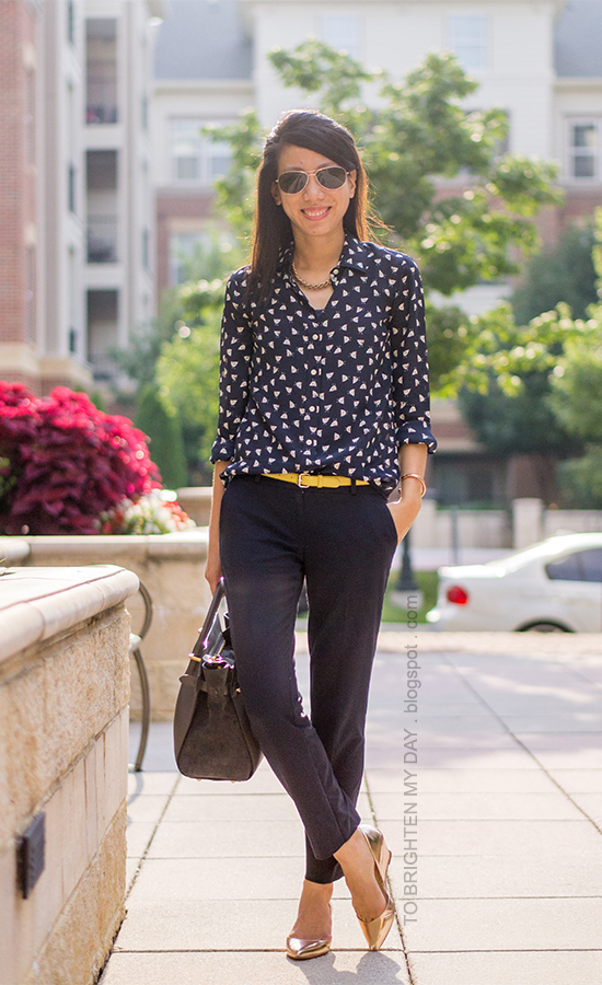 navy printed silk blouse, yellow belt, navy pants, rose gold metallic wedges