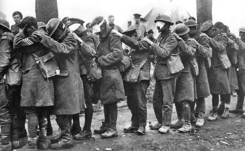 British 55th (West Lancashire) Division troops blinded by tear gas await treatment 10 April 1918, part of the German offensive in Flanders.
