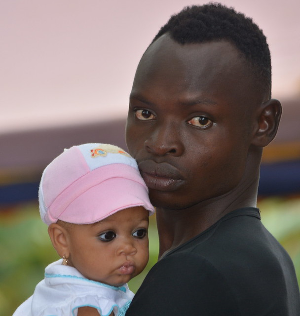 Baby with eyeliner.  Togo, Africa.