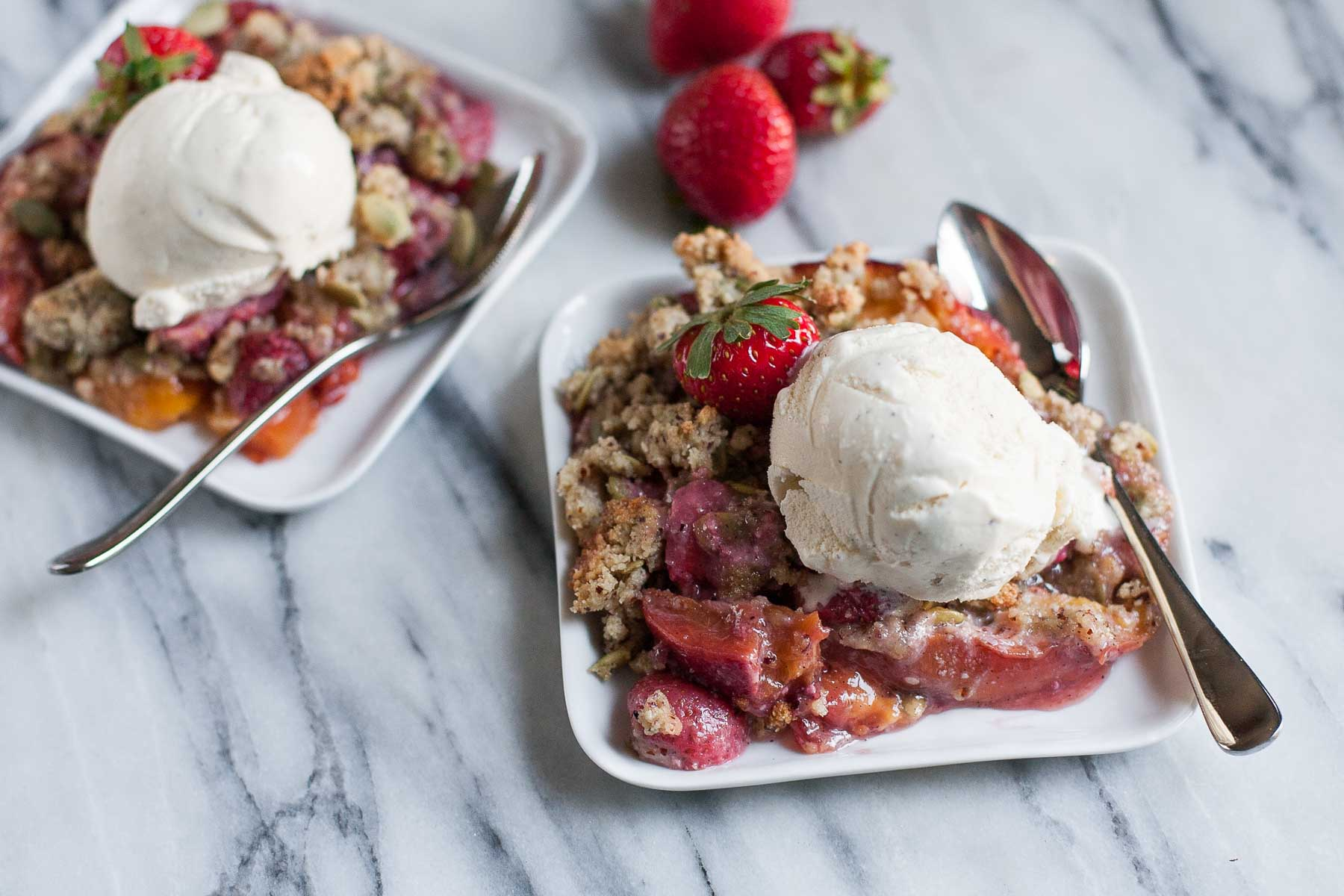 Strawberry-Peach Crisp with Hazelnut-Pepita Crumble | acalculatedwhisk.com
