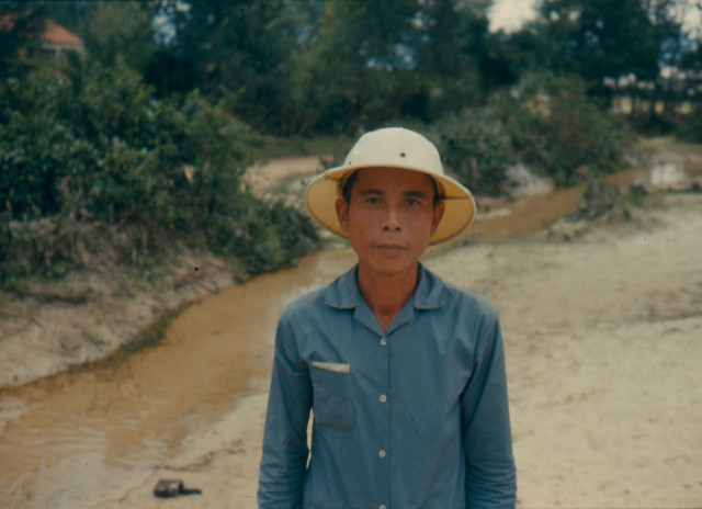 Vietnam War 1966 - Portrait of Vietnamese man with hat