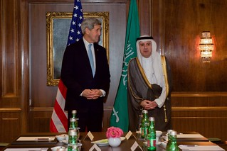 Secretary Kerry Listens as Saudi Arabia Foreign Minister Adel al-Jubeir Answers a Reporter's Question