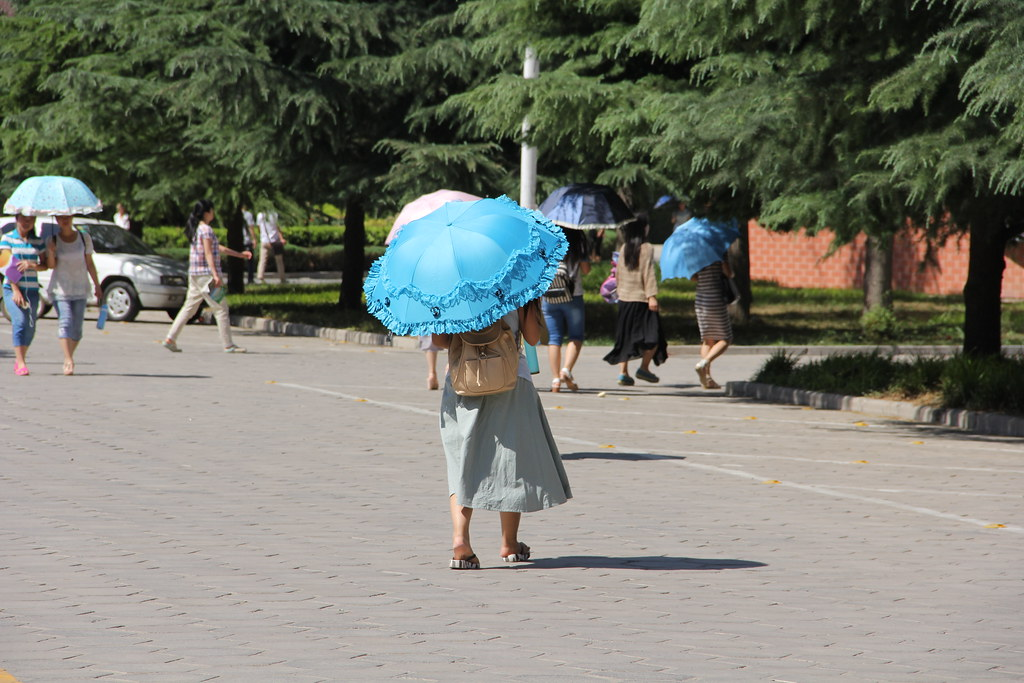 estudante com guarda-sol, Anyang, China