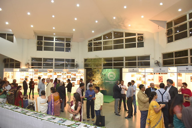 Attendees and dignitaries going through the exhibit before the award ceremony