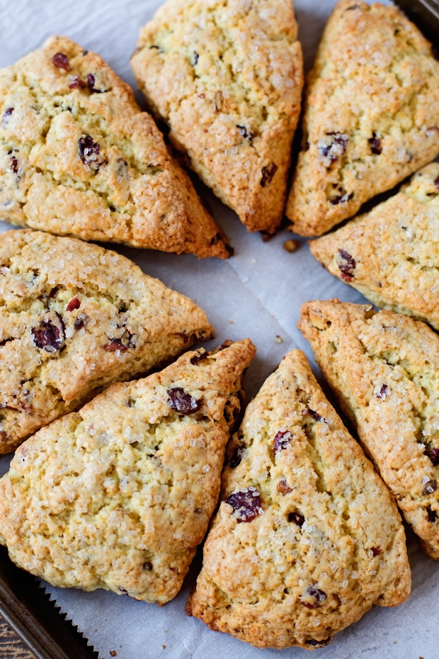 Cranberry Orange Scones with Pistachios - these scones are tender and flakey. The pistachios add such a nice nuttiness and crunch! #orangescones #pistachioscones #cranberryorangescones #scones | Littlespicejar.com