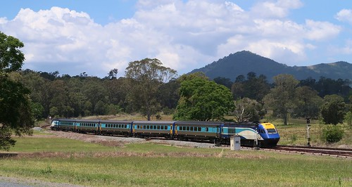 Sydney to Casino passenger service #NT33 departs Mount George, NSW (a)
