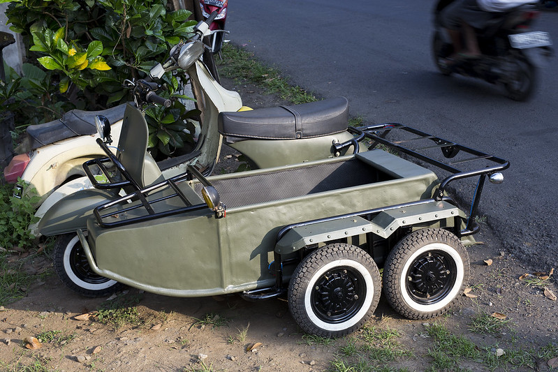 Scooter with sidecar.
